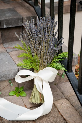 Purple lavender with fern accents tied with white ribbon