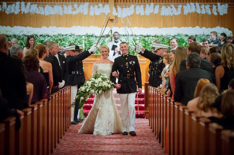Bride in Isabelle Armstrong wedding dress with groom in dress blues uniform at military church weddi