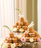 krispy kreme tower of glazed doughnuts on stands in cake form flowers at base and top
