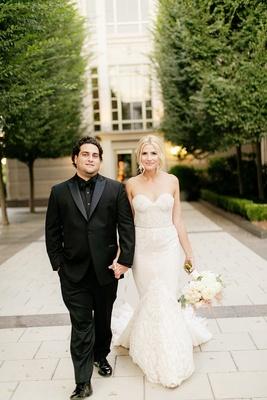 bride in inbal dror mermaid wedding dress, groom in all black tuxedo, black dress shirt