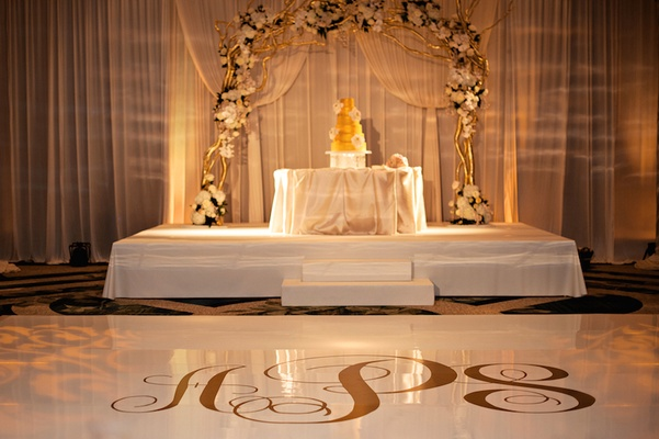 White and gold dance floor and cake stage