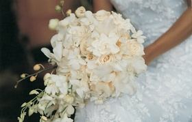 bridal bouquet of white roses and hawaiian orchids