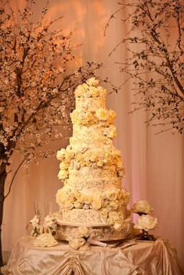 Six layer wedding cake with fresh flowers and lace