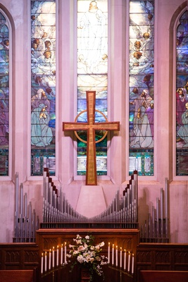 Wedding venue church in indianapolis indiana large cross stained glass window organ pipes flowers