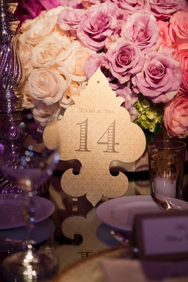 Gold reception table number on fleur de lys cut out