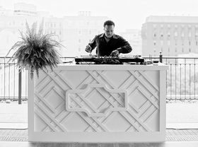 Black and white photo of DJ with Washington dc buildings in background