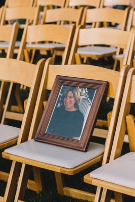Photo on ceremony chair of mother of groom