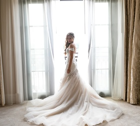 bride in stella york lace gown with champagne lining, lace, off-the-shoulder neckline