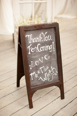 Standing chalkboard sign with note from couple
