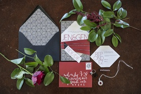 Wedding invitation suite in red, black, white with geometric shapes, patterns