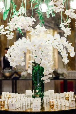 wedding reception in germany hotel venue white orchid greenery overhead vase die cut cards