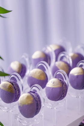 Wedding reception purple macaron desserts gold decorations on mini clear chairs ghost chair display