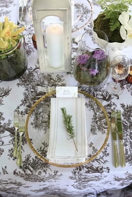 Vintage pattern linens on wedding table with fresh herbs