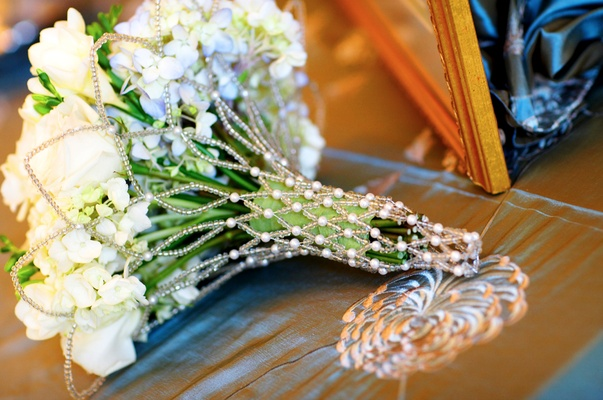 White bouquet inside pearl and clear bead holder