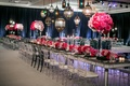 Mirror reception table with pink flowers and colorful glass lanterns