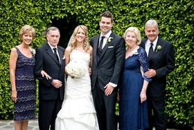 Bride and groom with fathers and mothers