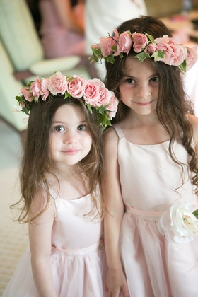 Flower girls in light pink dresses with matching flower head wreaths