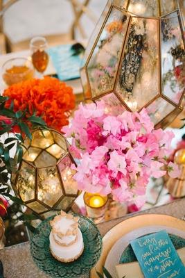 bright floral candle arrangement wedding reception tablescape unique quote napkin