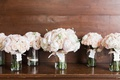 wedding bouquets in glass vases pink white peonies garden roses bride bridesmaids