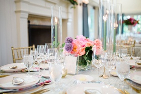 wedding reception low centerpiece light green taper candles purple allium and pink rose peony flower