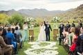 Wedding ceremony on grass golf course lawn Silverleaf Club in Scottsdale Arizona flower petal aisle