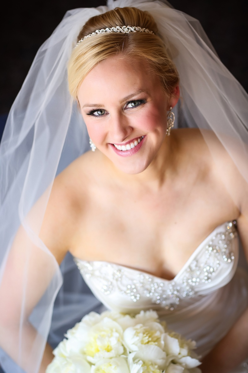 Blonde bride with crystal headband and diamond earrings