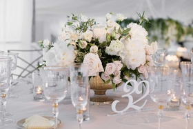 wedding reception low centerpiece footed vase white rose peony greenery flowers white cutout number