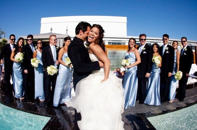 Los Angeles pool wedding bride and groom with guests