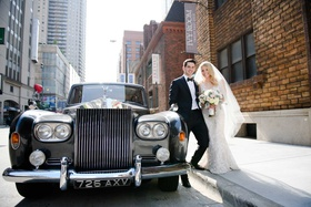 bride and groom with classic black car large silver grill london europe license plate chicago