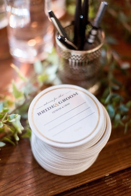 Wedding reception idea cocktail hour guest book alternative coasters with lines to write advice
