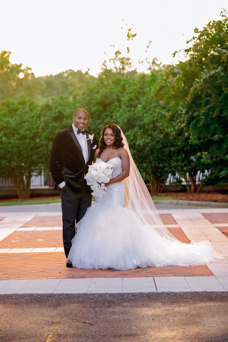 bride and groom for formal wedding mermaid wedding dress strapless sweetheart neckline velvet tuxedo