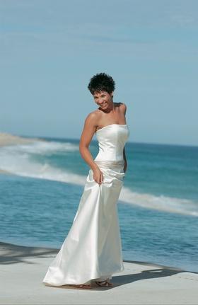White wedding dress with ivory sash around hips