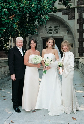Woman in strapless wedding dress outside church
