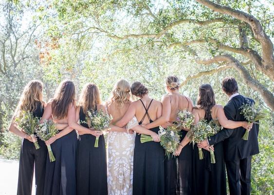 bride bridesmaids bridesman male bridesmaid wildflower bouquets navy blue dresses tuxedo forest