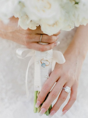 White bouquet with white wrap blue stone ring attached ribbon large engagement ring manicure french