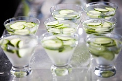 Short rocks glassware with cucumber garnish
