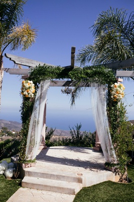 altar, green garland, rustic Malibu private venue wedding ceremony