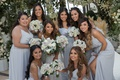 bride with bridesmaids in silver grey gowns muted bouquet long hair loose curls pampas grass decor