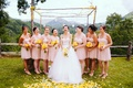 Bride with bridesmaids in front of wedding altar