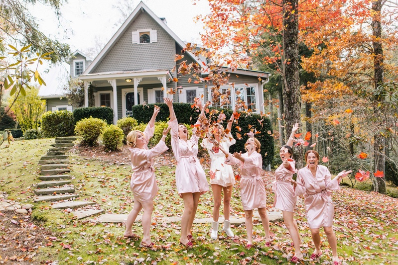 Beauty photos bride and bridesmaids in robes throw leaves bride and bridesmaids dressed in pink and white robes throw fall leaves into their air outside junglespirit Gallery