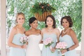 Indian bride with multicultural bridesmaids in strapless gowns