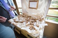 wine corks with gold safari animals attached as escort cards in vintage suitcase