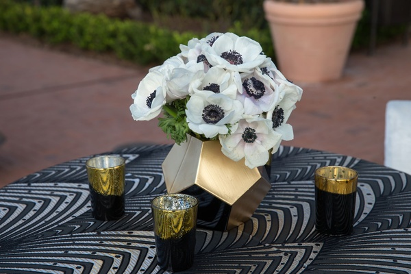 Wedding reception outdoor cocktail hour art deco linens with gold black candles and gold vase
