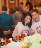 Bride and groom with lobster bibs at rehearsal dinner