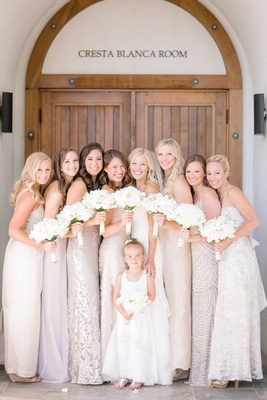 Bride and bridesmaids dressed in neutral dresses at Cresta Blaca Room, Wente Vineyards