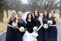 Bridesmaids in Amsale navy blue bridesmaid dresses with white bouquets