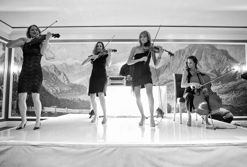 Black and white photo of women playing instruments