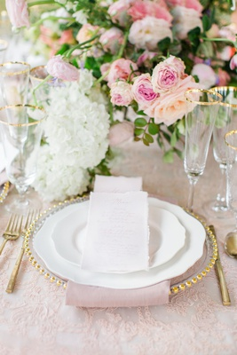 embroidered blush linens, gold trimmed charger, white china