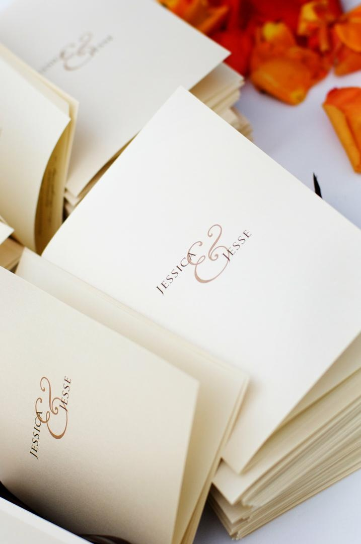 Large ampersand on ceremony booklet