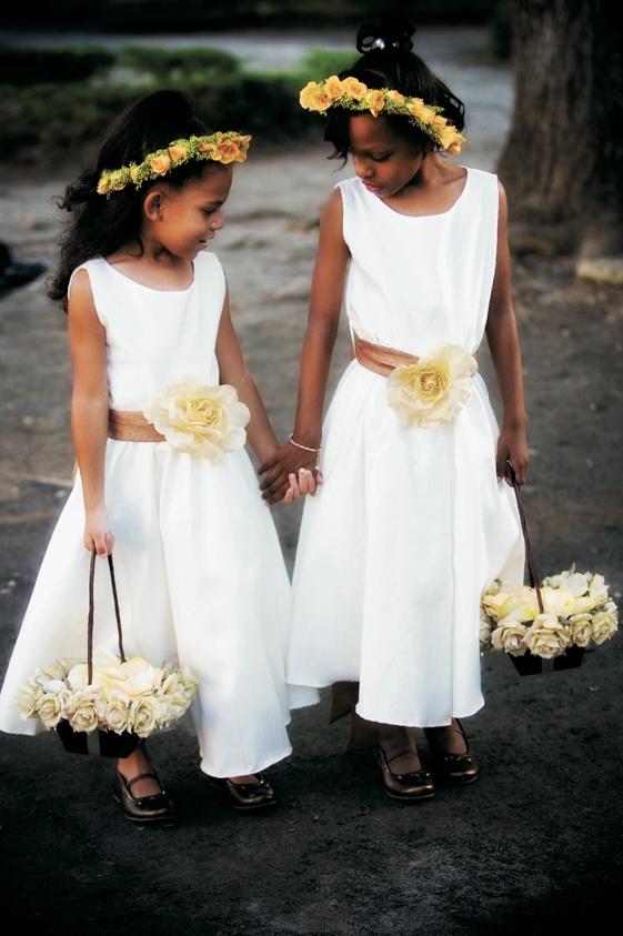 African American flower girls in white dresses